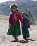 Portrait of a Native Peruvian girl and her little brother dresse Royalty Free Stock Image