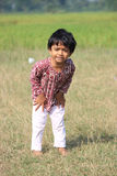 Portrait of a naughty child. A child is in the field Royalty Free Stock Image