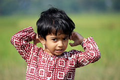 Portrait of a naughty child. A child is in the field Royalty Free Stock Photos