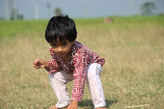 Portrait of a naughty child. A child is playing in the field Royalty Free Stock Photos