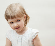 Portrait of a naughty little girl Stock Image