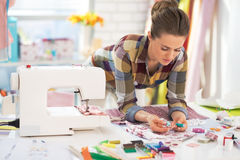 Portrait of needlewoman at work. In her modern studio Royalty Free Stock Image