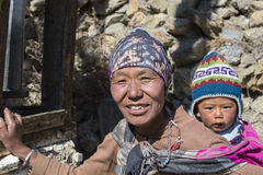Portrait nepalese mother and child on the street in Himalayan village, Nepal Royalty Free Stock Photos