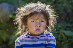Portrait nepali child on the street in Himalayan village, Nepal Stock Image