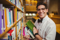 Portrait of nerd holding books Stock Photography