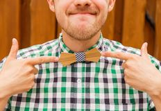 Portrait of nerd in wooden bowtie Royalty Free Stock Images