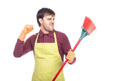 Portrait of nervous young man holding a sweep,conceptual image, Stock Images