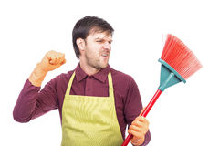 Portrait of nervous young man holding a sweep,conceptual image, Stock Image