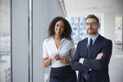 Portrait Of New Business Owners In Empty Office Stock Image