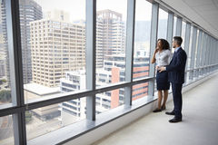 Portrait Of New Business Owners By Empty Office Window Royalty Free Stock Photography