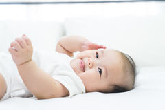 Portrait of a newborn Asian baby on the bed Royalty Free Stock Images