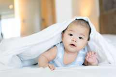 Portrait of a newborn Asian baby on the bed Royalty Free Stock Image