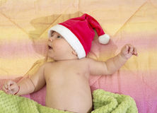 Portrait of a newborn baby boy with santa's hat in bed Royalty Free Stock Photography