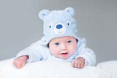 Portrait of newborn baby boy in teddy bear hat Royalty Free Stock Photos