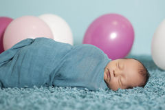 Portrait of newborn baby girl with balloons Royalty Free Stock Photography
