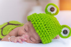 Portrait of newborn baby girl sleep on the bed Stock Photo