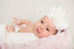 Portrait of newborn baby girl  with white headband Stock Images