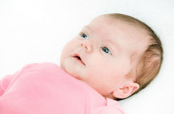 Portrait newborn baby lying in bed Royalty Free Stock Photos