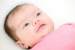 Portrait newborn baby lying in bed Stock Photography