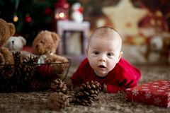 Portrait of newborn baby in Santa clothes in little baby bed Stock Photos