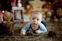 Portrait of newborn baby in Santa clothes in little baby bed Royalty Free Stock Images