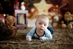 Portrait of newborn baby in Santa clothes in little baby bed Royalty Free Stock Image