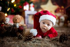 Portrait of newborn baby in Santa clothes in little baby bed. Winter snow landscape outdoor stock photos