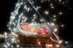 Portrait of a newborn child under a fairy umbrella. With stars Royalty Free Stock Images
