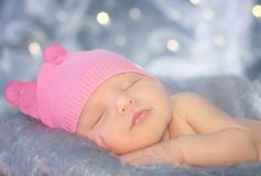 Portrait of a newborn girl. In a pink hat Stock Images