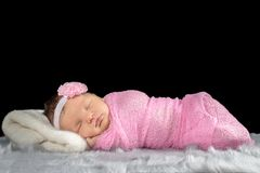 Portrait of a newborn girl. Wrapped in a pink shawl Royalty Free Stock Images