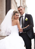 Portrait of newly married couple hugging against old styled building Stock Photography