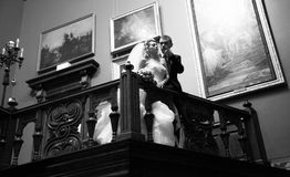 portrait of newly married couple hugging at old palace Royalty Free Stock Photos