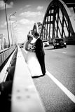 Portrait of newly married couple hugging on road Royalty Free Stock Photos