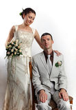 Portrait of newly-married couple, humorous concept stock images
