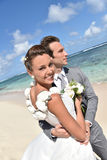 Portrait of newly-weds on the caribbean beach Royalty Free Stock Image