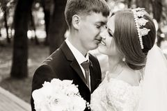 Portrait of a newlywed couple on a wedding walk. Concept of a happy young couple. stock photos