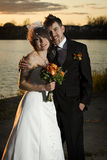 Portrait of newlyweds. Along river bank Royalty Free Stock Photography