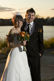 Portrait of newlyweds. Along riverbank Royalty Free Stock Photography