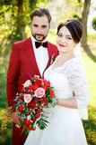 Portrait of newlyweds couple outdoors, summer. Royalty Free Stock Images