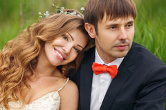 Portrait newlyweds in the lush spring garden Stock Image