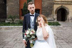 Portrait of newlyweds near the church stock photo