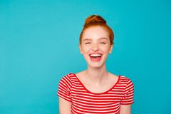 Portrait of nice adorable attractive lovely dreamy cheerful tren. Dy glad red-haired girl with bun, wearing t-shirt, opened mouth, isolated on teal pastel bright stock images