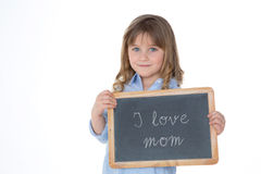 Portrait of nice child holding blackboard Royalty Free Stock Photos