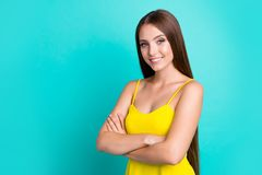 Portrait of nice content attractive cute sweet tender charming s. Traight-haired girl in bright tanktop, isolated over green turquoise teal pastel background royalty free stock image