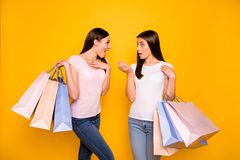 Portrait of nice cute charming girlish sweet attractive cheerful straight-haired teen girls holding in hands carrying. New cool purchase isolated on bright royalty free stock photos