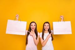 Portrait of nice cute charming lovely attractive cheerful cheery positive straight-haired girls carrying showing new. Cool purchase isolated on bright vivid stock photo
