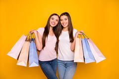 Portrait of nice cute charming lovely attractive cheerful cheery straight-haired girl embracing holding in hands new. Cool bags purchase isolated on bright stock photography