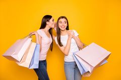 Portrait of nice cute charming winsome girlish attractive cheerful cheery straight-haired teenage girls carrying new. Purchase sharing secret isolated on bright stock photos