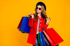 Portrait of nice cute dreamy elegant chic classy adorable attrac. Tive curly-haired lady in round eyeglasses eyewear holding colorful bags curls wear outfit stock photo