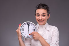 Portrait of nice girl holding big clock in her Royalty Free Stock Photos